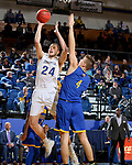 SIOUX FALLS, SD - NOVEMBER 28: Mike Daum #24 from South Dakota State University takes the ball to the basket past Danny Dixon #4 from UMKC during their game Wednesday night at Frost Arena in Brookings, SD. (Photo by Dave Eggen/Inertia)