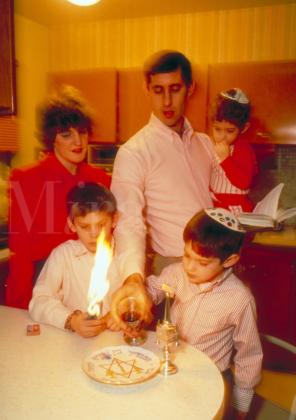 A Jewish family observes Havdalah. Ceremony. Sabbath. Judaism. People. Jewish family.