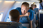 Spartak Trnava v St Johnstone...06.08.14  Europa League Qualifier 3rd Round<br /> Steven Anderson talks to Stevie Bnaks on the flight to Bratislava<br /> Picture by Graeme Hart.<br /> Copyright Perthshire Picture Agency<br /> Tel: 01738 623350  Mobile: 07990 594431