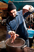 La Vucciria market in Palermo - Sergio Lo Presti, a fisherman who sell his fresh catch of octopus - boiled and served with a squeeze of fresh lemon juice.