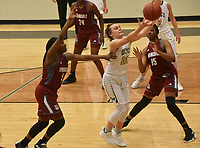 NWA Democrat-Gazette/FLIP PUTTHOFF <br /> Kelsey Wood (12) goes for a rebound Tuesday Jan. 8 2019 with Springdale players Jeniya Gause (5), Marquesha Davis (24) and Ashley Pegue (15).
