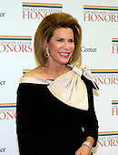 Ambassador Nancy Goodman Brinker, founder and CEO of Susan G. Komen for the Cure Foundation, arrives for the formal Artist's Dinner honoring the recipients of the 2012 Kennedy Center Honors hosted by United States Secretary of State Hillary Rodham Clinton at the U.S. Department of State in Washington, D.C. on Saturday, December 1, 2012. The 2012 honorees are Buddy Guy, actor Dustin Hoffman, late-night host David Letterman, dancer Natalia Makarova, and the British rock band Led Zeppelin (Robert Plant, Jimmy Page, and John Paul Jones)..Credit: Ron Sachs / CNP