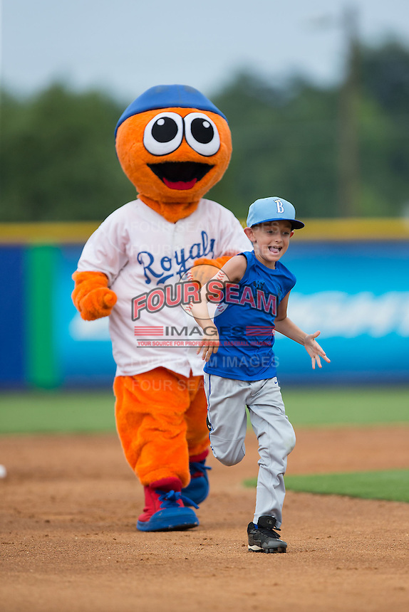 """A young fan races the Burlington Royals mascot """"Bingo"""" around the bases between innings of the game against the Danville Braves at Burlington Athletic Park on July 12, 2015 in Burlington, North Carolina.  The Royals defeated the Braves 9-3. (Brian Westerholt/Four Seam Images)"""