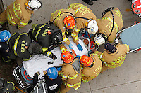 A construction worker is wheeled on a stretcher to a waiting ambulance by members of the FDNY in East Harlem, Manhattan, NY on Friday, March 2, 2012.  The worker was inside of a deep ditch he was helping to dig, when the dirt walls caved in on him, burying him up to his neck. Members of the FDNY and NYPD were successful in rescuing him.