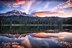 Colorful sunrise over Mount Rainer with reflection in lakr