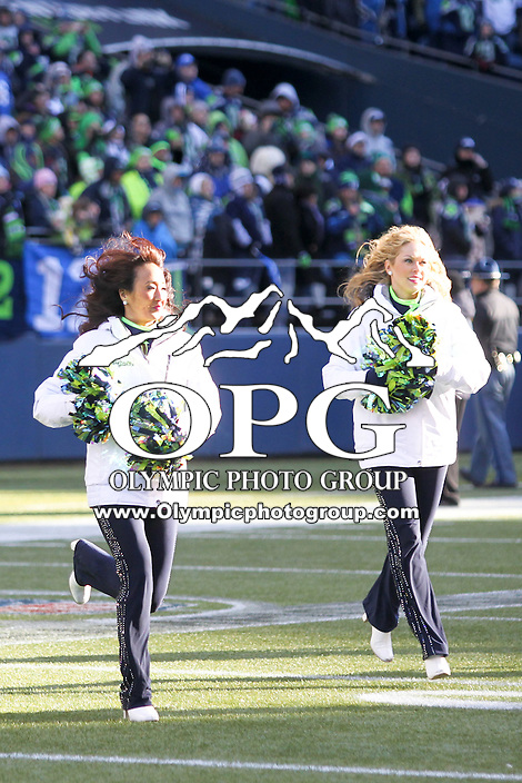 2014-02-05:  Seattle Seahawks Cheerleaders Entertained the fan's during the Super Bowl Parade celebration at Century Link Field.  Players and 12th man fans celebrated bringing the Lombardi trophy home to Seattle during the Super Bowl Parade at Century Link Field in Seattle, WA.