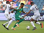 Kevan George (19) of Trinidad and Tobago (left) and Carlyle Mitchell (12) of Trinidad and Tobago (right) double-team Emery Welshman (10) of Guyana during their Gold Cup match on June 26, 2019 at Children's Mercy Park in Kansas City, KS.<br /> Tim VIZER/AFP
