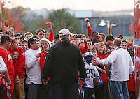 The Buckeye faithful and a handful of Penn State fans strain to get a look at the team as they exit the buses at Beaver Stadium on October 25, 2014.  (Chris Russell/Dispatch Photo)