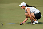 CHON BURI, THAILAND - FEBRUARY 19:  Michelle Wie of USA lines up a putt on the 12th green during day three of the LPGA Thailand at Siam Country Club on February 19, 2011 in Chon Buri, Thailand. Photo by Victor Fraile / The Power of Sport Images