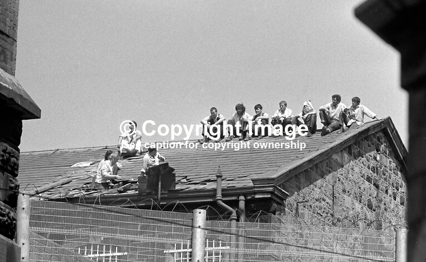 Prisoners protesting on the rooftop of the Crumlin Road Jail, Belfast, N Ireland, 20 July 1972. During the rooftop protest one prisoner was wounded by a shot from a sniper. MORE CAPTION INFO TO FOLLOW. 197207200419c.<br /> <br /> Copyright Image from Victor Patterson, 54 Dorchester Park, <br /> Belfast, UK, BT9 6RJ<br /> <br /> t1: +44 28 9066 1296 (from Rep of Ireland 048 9066 1296)<br /> t2: +44 28 9002 2446 (from Rep of Ireland 048 9002 2446)<br /> m: +44 7802 353836<br /> <br /> e1: victorpatterson@me.com<br /> e2: victorpatterson@gmail.com<br /> www.victorpatterson.com<br /> <br /> Please see my Terms and Conditions of Use at www.victorpatterson.com. It is IMPORTANT that you familiarise yourself with them.<br /> <br /> Images used on the Internet must be visibly watermarked i.e. &copy; Victor Patterson<br /> within the body of the image and copyright metadata must not be deleted. Images <br /> used on the Internet have a size restriction of 4kbs and will be chargeable at current<br />  NUJ rates unless agreed otherwise.<br /> <br /> This image is only available for the use of the download recipient i.e. television station, newspaper, magazine, book publisher, etc, and must not be passed on to any third <br /> party. It is also downloaded on condition that each and every usage is notified within 7 days to victorpatterson@me.com<br /> <br /> The right of Victor Patterson to be identified as the author is asserted in accordance with The Copyright Designs And Patents Act (1988).