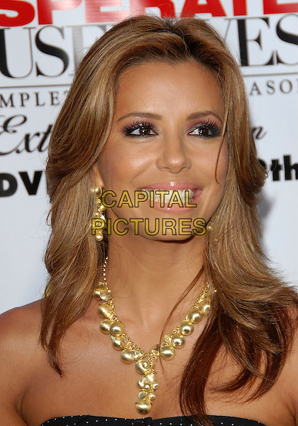 EVA LONGORIA.The Desperate Housweives: Extra Juicy Season 2 DVD Launch held at Wisteria Lane in Universal City, California, USA..August 5th, 2006.Ref: DVS.headshot portrait gold necklace earrings.www.capitalpictures.com.sales@capitalpictures.com.©Debbie VanStory/Capital Pictures