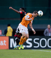 Cam Weaver (15) of the Houston Dynamo goes up for a header with James Riley (2) of D.C. United during a Major League Soccer game at RFK Stadium in Washington, DC. D.C. United vs. Houston Dynamo, 2-1.