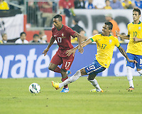 Brazil midfielder Luiz Gustavo (17) tackles Portugal forward Nani (17).  In an International friendly match Brazil defeated Portugal, 3-1, at Gillette Stadium on Sep 10, 2013.