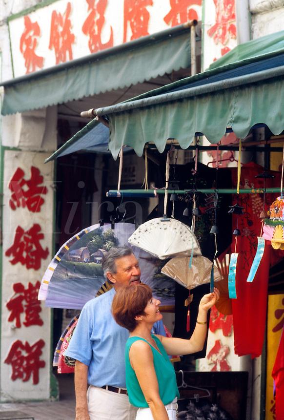 Touist retired couple shopping in Singapor