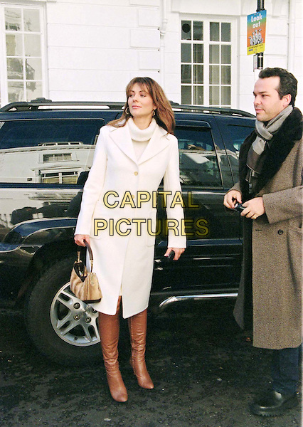 LIZ HURLEY & HENRY DENT BROCKLEHURST.paparazzi picture, white coat, brown boots, full length, full-length.www.capitalpictures.com.sales@capitalpictures.com.© Capital Pictures