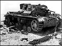 BNPS.co.uk (01202 558833)Pic:    Pen&Sword/BNPS<br /> <br /> A destroyed Panzer tank.  Debris can be seen littered around where shells have struck the side of the vehicle, ripping off the track.  One of the deceased crew can be seen sprawled out.<br /> <br /> Fascinating rare photos of Rommel's feared Afrika Korps which terrorised the Allies in the desert have come to light in a new book.<br /> <br /> Under the direction of legendary German commander Field Marshal Erwin Rommel, who was nicknamed the Desert Fox, the corps were recognised as a superb fighting machine.<br /> <br /> They achieved their greatest triumph when they outmanoeuvred the British at the Battle of Gazala in June 1942 which led to them capturing Tobruk in Libya.<br /> <br /> But they were ultimately defeated in the iconic Battle of Alamein when they succumbed to an offensive led by Field Marshal Bernard Montgomery.