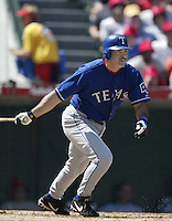 Rafael Palmeiro of the Texas Rangers bats during a 2002 MLB season game against the Los Angeles Angels at Angel Stadium, in Los Angeles, California. (Larry Goren/Four Seam Images)