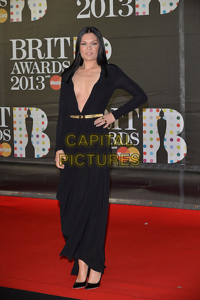 Jessie J (Jessica Ellen Cornish).The Brit Awards 2013 arrivals at the O2, Greenwich, London, England 20th February 2013.The Brits full length black low cut dress  gold belt long maxi sleeve plunging neckline shoes hand on hip .CAP/PL.©Phil Loftus/Capital Pictures.