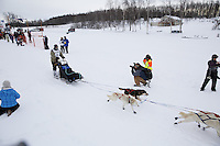 Jimmy Lanier and dog team leaves the start line of the 2013 Junior Iditarod on Knik Lake.  Knik Alaska..Photo by Jeff Schultz/IditarodPhotos.com   Reproduction prohibited without written permission