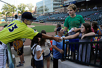 Infielder Andres Gimenez (13) of the Columbia Fireflies signs an autograms before a game against the Augusta GreenJackets on Saturday, July 29, 2017, at Spirit Communications Park in Columbia, South Carolina. Columbia won, 3-0. (Tom Priddy/Four Seam Images)