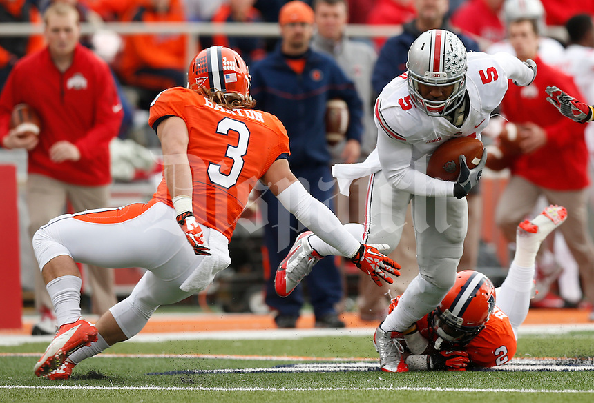 Ohio State Buckeyes quarterback Braxton Miller (5) is tackled by Illinois Fighting Illini defensive back V'Angelo Bentley (2) during the first half of Saturday's NCAA Division I football game at Memorial Stadium in Champaign, Il., on November 16, 2013. Ohio State won the game 60-35. (Barbara J. Perenic/The Columbus Dispatch)