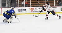 Verona's Cale Rufenacht takes a shot toward Madison West goaltender, Ian Hedican in the second period, as Madison West takes on Verona in Wisconsin Big Eight conference boys high school hockey on Friday, 1/3/20 at the Verona Ice Arena