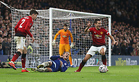 Chelsea's Eden Hazard goes down from the challenge of Manchester United's Victor Lindelof with Ander Herrera in close attendance<br /> <br /> Photographer Rob Newell/CameraSport<br /> <br /> Emirates FA Cup Fifth Round - Chelsea v Manchester United - Monday 18th February - Stamford Bridge - London<br />  <br /> World Copyright © 2019 CameraSport. All rights reserved. 43 Linden Ave. Countesthorpe. Leicester. England. LE8 5PG - Tel: +44 (0) 116 277 4147 - admin@camerasport.com - www.camerasport.com