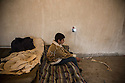 A Syrian boy sits on an old mattress at Harmanli, a former military camp where refugees were accommodated beginning in 2013. Some were made to stay in unfinished and unheated buildings while others stayed in military tents despite the cold weather.