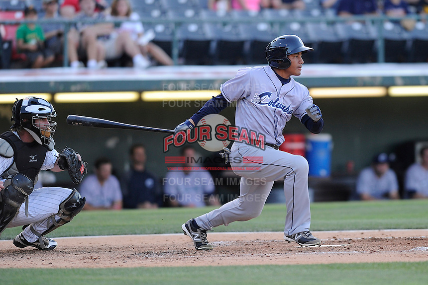 Center fielder Ezequiel Carrera (10) of the Columbus Clippers bats in a game against the Charlotte Knights on Saturday, June 15, 2013, at Knights Stadium in Fort Mill, South Carolina. The Charlotte catcher is Bryan Anderson. Columbus won, 4-2. (Tom Priddy/Four Seam Images)