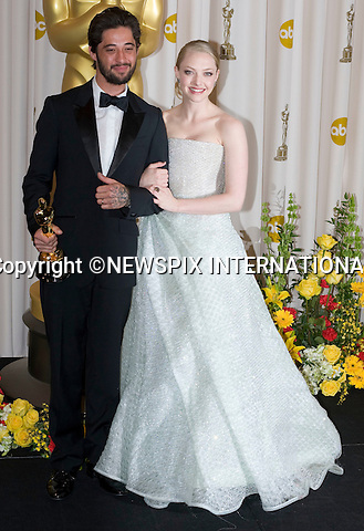 """Amanda Seyfried with Ryan Bingham, winner of Best Song award.OSCARS 2010 PHOTOROOM.The 82nd Academy Awards_Kodak Theatre, Hollywood, Los Angeles_07/03/2009.Mandatory Photo Credit: ©Dias/Newspix International..**ALL FEES PAYABLE TO: """"NEWSPIX INTERNATIONAL""""**..PHOTO CREDIT MANDATORY!!: NEWSPIX INTERNATIONAL(Failure to credit will incur a surcharge of 100% of reproduction fees)..IMMEDIATE CONFIRMATION OF USAGE REQUIRED:.Newspix International, 31 Chinnery Hill, Bishop's Stortford, ENGLAND CM23 3PS.Tel:+441279 324672  ; Fax: +441279656877.Mobile:  0777568 1153.e-mail: info@newspixinternational.co.uk"""