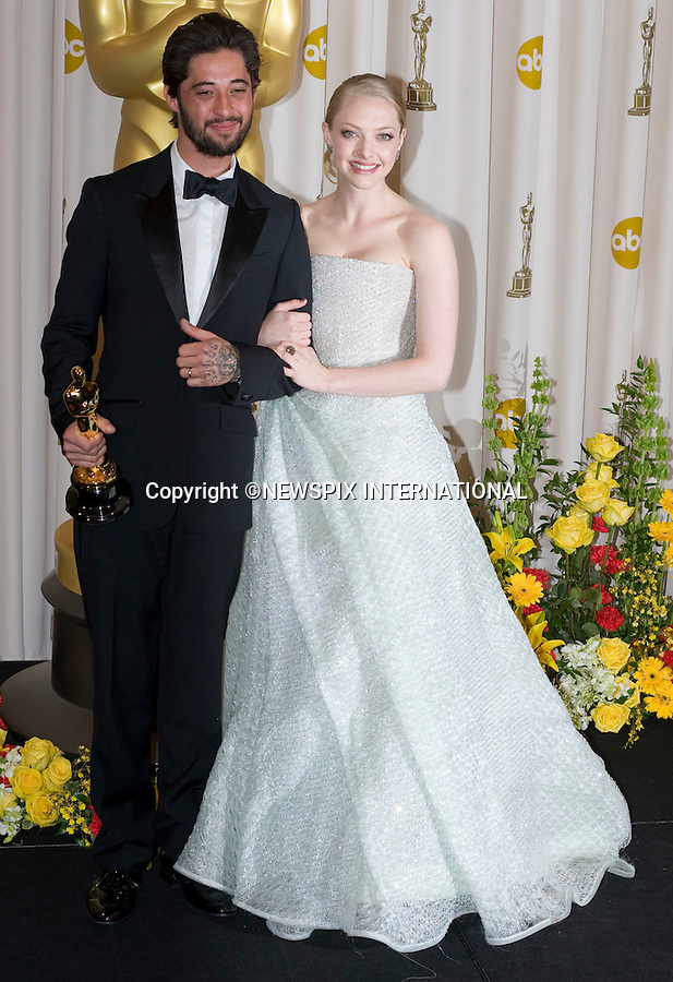 "Amanda Seyfried with Ryan Bingham, winner of Best Song award.OSCARS 2010 PHOTOROOM.The 82nd Academy Awards_Kodak Theatre, Hollywood, Los Angeles_07/03/2009.Mandatory Photo Credit: ©Dias/Newspix International..**ALL FEES PAYABLE TO: ""NEWSPIX INTERNATIONAL""**..PHOTO CREDIT MANDATORY!!: NEWSPIX INTERNATIONAL(Failure to credit will incur a surcharge of 100% of reproduction fees)..IMMEDIATE CONFIRMATION OF USAGE REQUIRED:.Newspix International, 31 Chinnery Hill, Bishop's Stortford, ENGLAND CM23 3PS.Tel:+441279 324672  ; Fax: +441279656877.Mobile:  0777568 1153.e-mail: info@newspixinternational.co.uk"