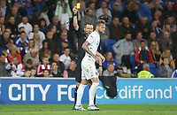 Liam Cooper of Leeds United receives a yellow card during the Sky Bet Championship match between Cardiff City and Leeds United at The Cardiff City Stadium, Cardiff, Wales, UK. Tuesday 26 September 2017