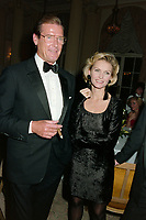 ARCHIVE: CANNES, FRANCE. c. May 1991: Roger Moore & Fiona Fullerton at the Cannes Film Festival.<br /> File photo © Paul Smith/Featureflash