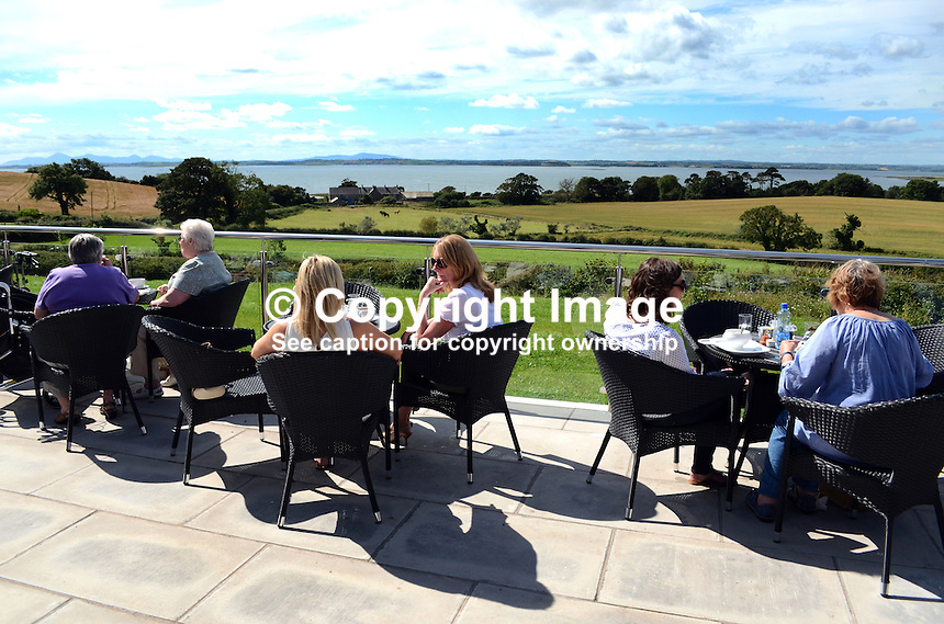 Harrison's Restaurant, Greyabbey, Co Down, N Ireland, UK, open-air, alfresco, dining, with a view of Strangford Lough and the Mournes. 201208180513..Copyright Image from Victor Patterson, 54 Dorchester Park, Belfast, UK, BT9 6RJ..Tel: +44 28 9066 1296.Mob: +44 7802 353836.Voicemail +44 20 8816 7153.Skype: victorpattersonbelfast.Email: victorpatterson@me.com.Email: victorpatterson@ireland.com (back-up)..IMPORTANT: If you wish to use this image or any other of my images please go to www.victorpatterson.com and click on the Terms & Conditions. Then contact me by email or phone with the reference number(s) of the image(s) concerned.