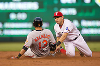 Texas Rangers second baseman Ian Kinsler #5 tags out Oriole baserunner Manny Machado #13 at second base during the Major League Baseball game against the Baltimore Orioles on August 21st, 2012 at the Rangers Ballpark in Arlington, Texas. The Orioles defeated the Rangers 5-3. (Andrew Woolley/Four Seam Images).