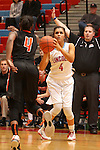 SIOUX FALLS, SD - DECEMBER 19: Sydney Miller #4 from Lincoln spots up for a jumper against Sam Haiby #4 from Moorhead in the first half of their game Friday night at Lincoln.  (Photo by Dave Eggen/Inertia)