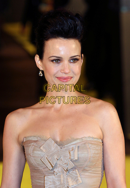 """CARLA GUGINO.At the UK Premiere of """"Watchmen"""" at Odeon Leicester Square, London, England, February 23rd 2009..portrait headshot strapless beige bows hair up .CAP/MAR.©Martin Harris/Capital Pictures"""
