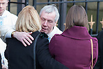© Joel Goodman - 07973 332324 . 16/01/2014 . Salford , UK . Mourners hug as the cortege arrives . The funeral of Labour MP Paul Goggins at Salford Cathedral today (Thursday 16th January 2014) . The MP for Wythenshawe and Sale East died aged 60 on 7th January 2014 after collapsing whilst out running on 30th December 2013 . Photo credit : Joel Goodman
