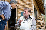 C.W. Nicol talks with forest ranger Nobuyoshi Matsuki by the ranger's hut in the C.W. Nicol Afan Woodland Trust, native woodland that Nicol began buying up 25 years ago, near his home in Kurohime, Nagano Prefecture, Japan on 10 May 2010..Photographer: Robert Gilhooly