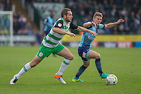 Dominic Gape of Wycombe Wanderers gets past Matthew Dolan of Yeovil Town during the Sky Bet League 2 match between Yeovil Town and Wycombe Wanderers at Huish Park, Yeovil, England on 8 October 2016. Photo by Mark  Hawkins / PRiME Media Images.
