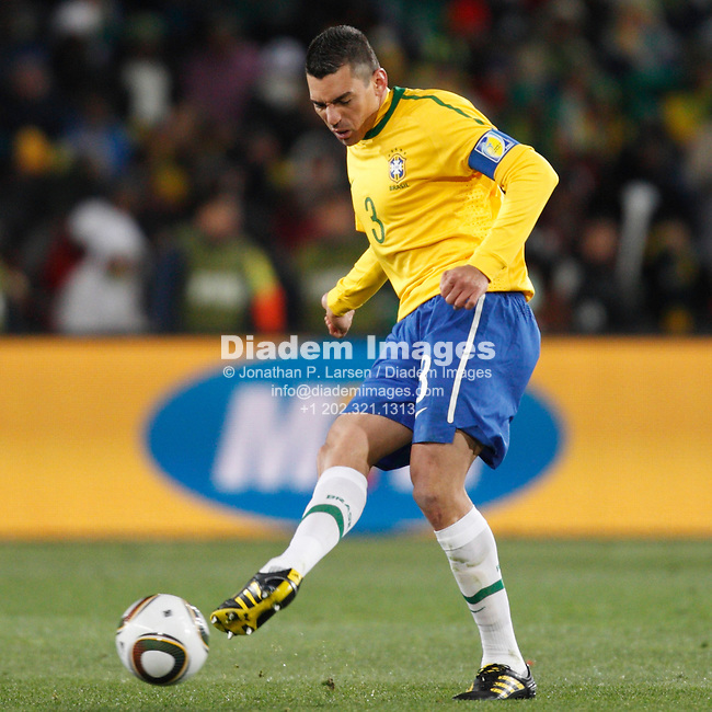 JOHANNESBURG - JUNE 15:  Brazil team captain Lucio passes the ball during a 2010 FIFA World Cup soccer match against North Korea June 15, 2010 in Johannesburg, South Africa.  NO mobile use.  Editorial ONLY.  (Photograph by Jonathan P. Larsen)