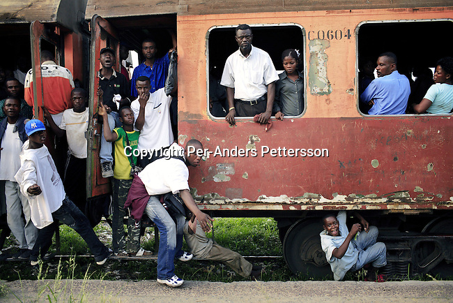 KINSHASA, DEMOCRATIC REPUBLIC OF CONGO APRIL 28: Unidentified passengers onboard the only commuter train on April 28, 2006 in central Kinshasa, Congo, DRC. Kinshasa, a city of about eight million people is battling with bad infrastructure and no public transport. The train makes one journey in each direction every day and thousands of people fight to get a place on it, The cars doesn?t have any seats. Its standing only so more people can fit. Congo, DRC is in ruins after forty years of mismanagement by the corrupt dictator and former president Mobuto Sese Seko. He fled the country in 1997 and a civil war started. The country is planning to hold general elections by July 2006, the first democratic elections in forty years.(Photo by Per-Anders Pettersson/)