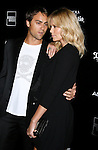 """BEVERLY HILLS, CA. - September 22: Writer/director Stuart Townsend and actress Charlize Theron arrive at a special screening of """"Battle in Seattle"""" held at the Clarity Theater on Monday September 22, 2008 in Beverly Hills, California.(Photo by Jeffrey Mayer/WireImge) *** Local caption ***"""