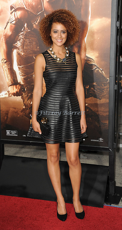 Nathalie Emmanuel at the RIDDICK World Premiere, held at the Regency Village Theater Los Angeles, Ca. August 28, 2013