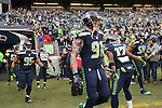 Seattle Seahawks Wide receiver Kevin Smith greets teammates as they depart the tunnel before their game against the Cleveland Browns at CenturyLink Field in Seattle, Washington on December 20, 2015. The Seahawks clinched their fourth straight playoff berth in four seasons by beating the Browns 30-13.  ©2015. Jim Bryant Photo. All Rights Reserved.