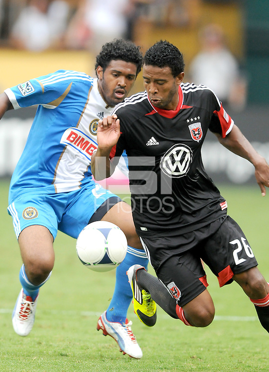 D.C. United forward Leonard Pajoy (26) shields the ball from Philadelphia Union defender Sheanon Willimas (25) D.C. United tied The Philadelphia Union 1-1 at RFK Stadium, Saturday August 19, 2012.