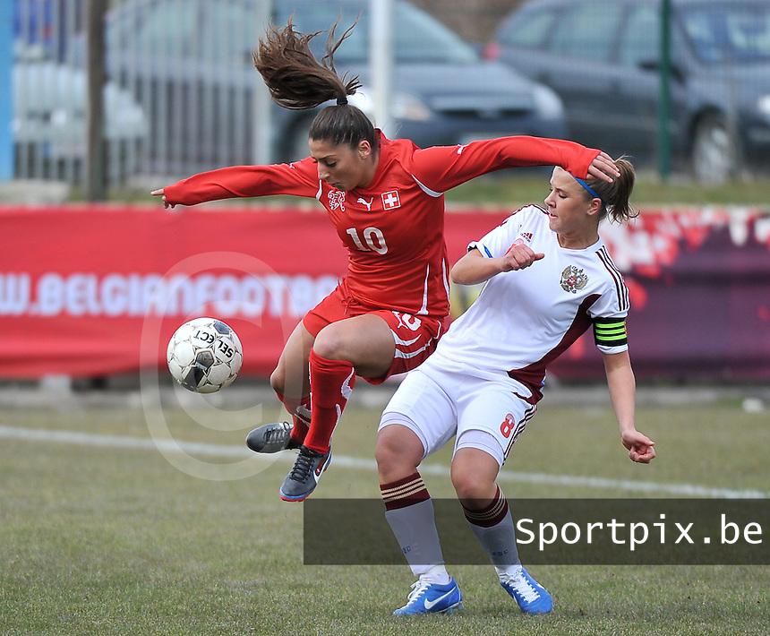 Switzerland U19 - Russia U19 : Switzerland number 10 Merjine Selimi in a duel with russian number 8 Anastasia Efimova.foto DAVID CATRY / Nikonpro.be