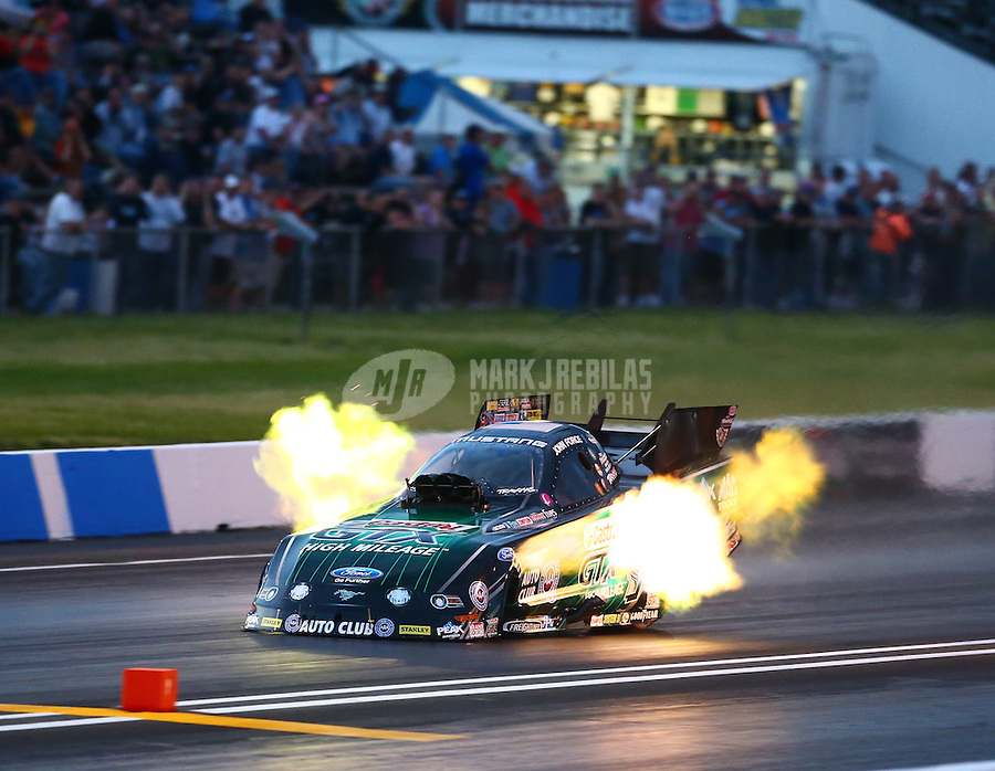 May 30, 2014; Englishtown, NJ, USA; NHRA funny car driver John Force during qualifying for the Summernationals at Raceway Park. Mandatory Credit: Mark J. Rebilas-
