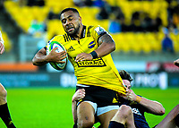 Ngani Laumape is tackled during the Super Rugby match between the Hurricanes and Highlanders at Westpac Stadium in Wellington, New Zealand on Friday, 1 March 2019. Photo: Dave Lintott / lintottphoto.co.nz