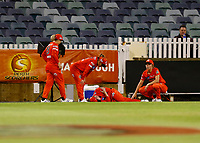 1st November 2019; Western Australia Cricket Association Ground, Perth, Western Australia, Australia; Womens Big Bash League Cricket, Perth Scorchers versus Melbourne Renegades; Claire Kossi of the Melbourne Renegades lays on the ground after injuring her arm trying to stop a boundary - Editorial Use